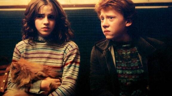 Emma Watson, Crookshanks die Katze haltend und Rupert Grint, 2004