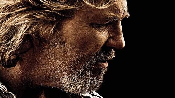 Jeff Bridges als Musiker mit Gitarre auf einem Filmposter zum Film ''Crazy Heart''.