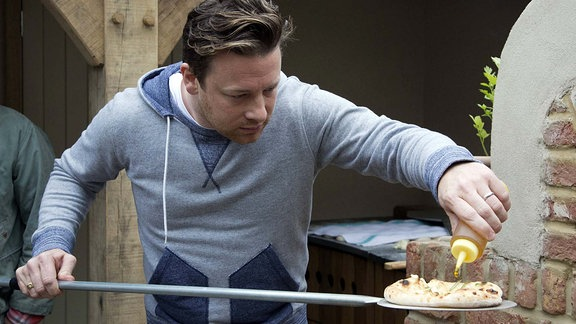 Chef Jamie Oliver baking bread.