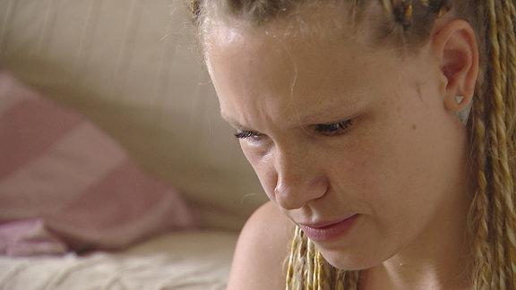 Ein Gesicht einer Frau nah