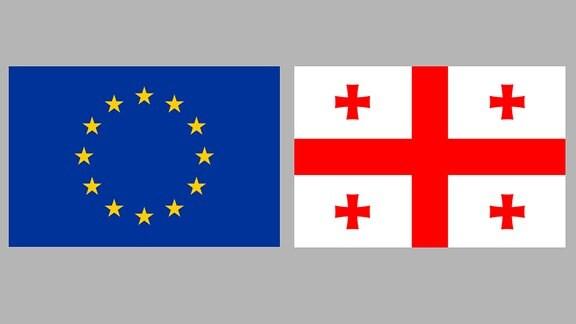 Flagge der EU und Georgiens
