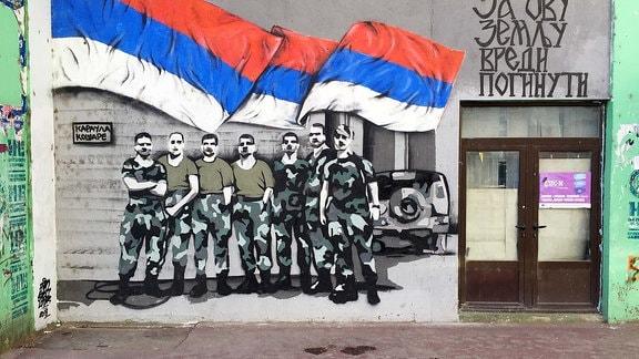 Kampf-Graffiti mit Flagge