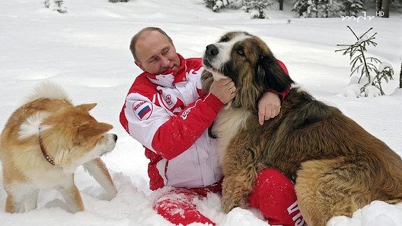 Putin mit zwei Hunden im Schnee