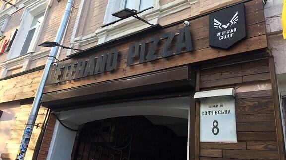 Der Eingangsbereich eines Kiewer Pizzaladens