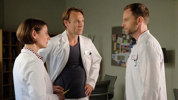Dr. Kai Hoffmann, Dr. Stein und Dr. Weber im Fachgespräch.