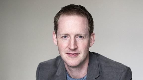 Porträt des Dirigenten Justin Doyle