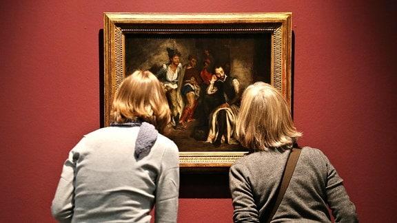 Zwei Frauen betrachten das Bild Tasso im Irrenhaus von Eugene Delacroix