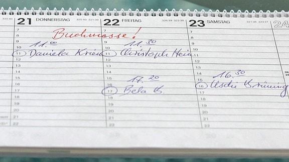 Ein Kalender mit dem Eintrag 'Buchmesse'.
