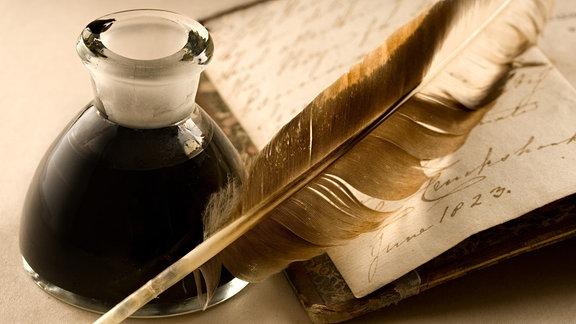 Schreibfeder und Tinte