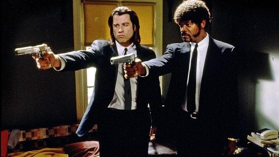 Samuel L. Jackson und John Travolta mit Pistolen, im Film «Pulp Fiction»