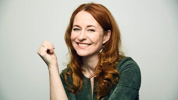 Katrin Schumacher posiert für ein Foto.