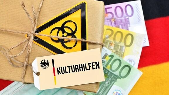 Paket mit Biogefährdungszeichen auf Deutschlandfahne mit Etikett und der Aufschrift Kulturhilfe