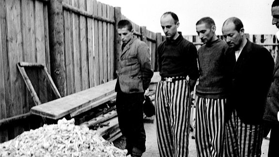 Lee Miller: Released prisoners in striped prison dress