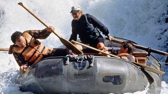 Menschen in einem Schlauchboot