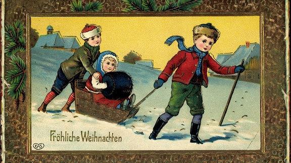 Historische Weihnachtspostkarte mit Schlitten fahrenden Kindern