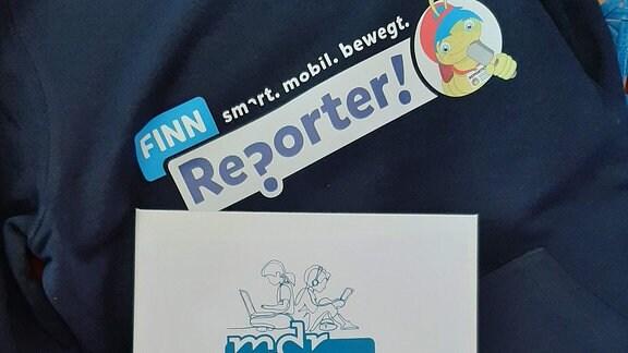 Über einer Urkunde ist der Schriftzug Finn-Reporter zu lesen.