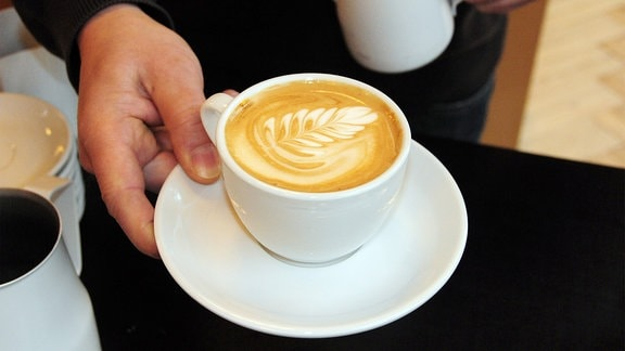 Eine Tasse mit Kaffee.