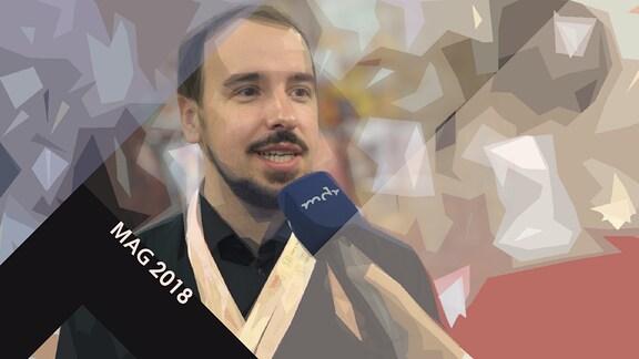 Wolf Lang beim Interview; Schriftzug MAG 2018