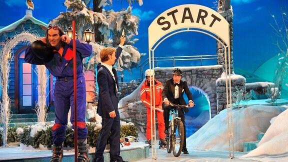 Guildo Horn, Florian Silbereisen und Patrick Lindner auf dem Fahrrad beim Winterfest der Volksmusik.