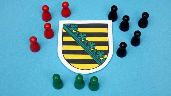 Symbolbild: Keniakoalition Sachsen - Logo mit Halmafiguren