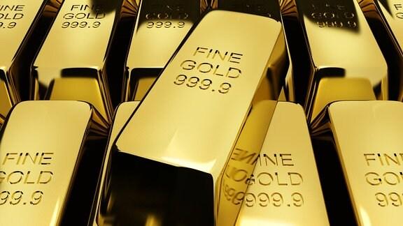 Goldbarren liegen gestapelt in einem Safe der Deutschen Bundesbank