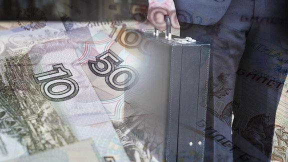 Mann mit Geldkoffer (russische Rubel) Mann mit Geldkoffer (russische Rubel)