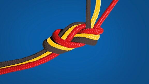 Ein Knoten aus schwarz, rot, gelben Seilen