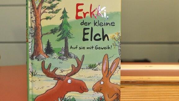 """Ein Buch mit der Aufschrift """"Erki, der kleine Elch"""""""