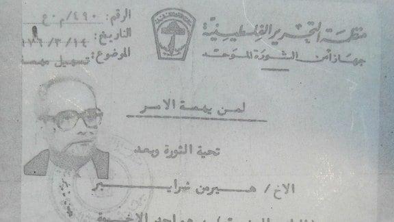 Ein Dokument mit einem Foto von Udo Albrecht und arabischer Schrift
