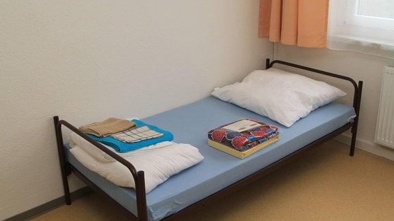Bett mit Erstausstattung