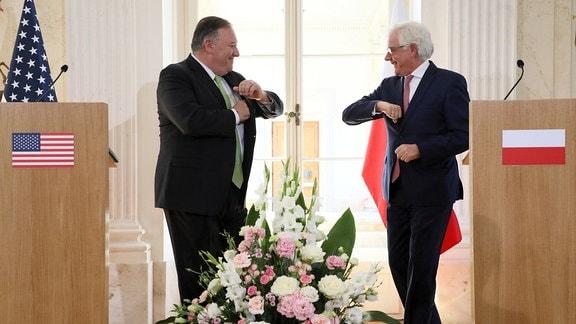 Der alte Außenminister Polens Czaputowicz mit Pompeo.