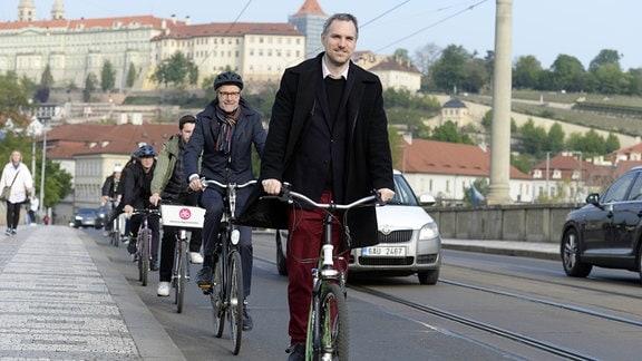 Prague Mayor Zdenek Hrib (front) and Ambassador of Denmark Ole Henrik Frijs-Madsen (centre) in action during the campaign Do prace na kole (Bike 2 Work) in Prague, Czech Republic, May 2, 2019.