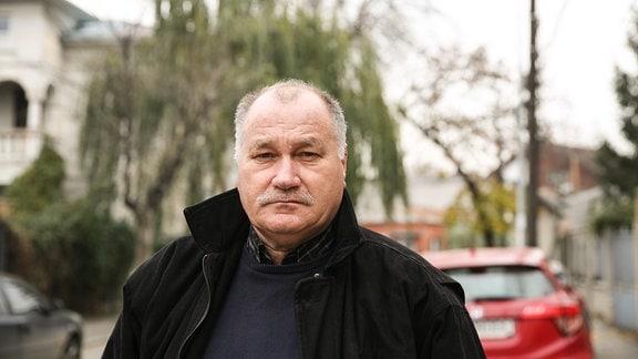 Dorin Carlan, Mann auf Straße in Bukarest