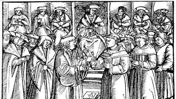 Der Reichstag zu Worms, 1521. Luther in Gegenwart von Kaiser Karl V. Luther rechts, Johann von der Ecken links zwischen ihnen.
