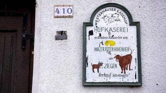 Eingangsschild von einem Käsehof