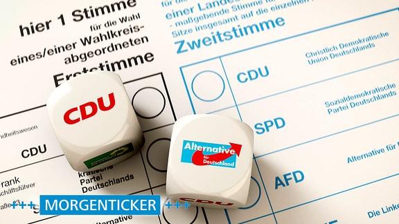Stimmzettel zur Bundestagswahl, auf dem 2 Würfel liegen, CDU und AfD