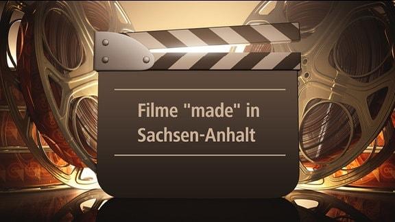 """Filmrollen und eine Filmklappe mit der Schrift: """"Flme made in Sachsen-Anhalt"""""""