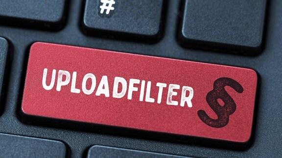 Computertaste mit der Aufschrift Uploadfilter und Paragrafenzeichen