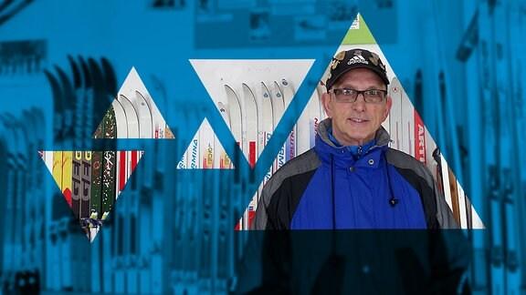 Ein Mann mit Brille und Cap steht vor einer Wand, an der viele Paare Ski aufgereiht stehen.