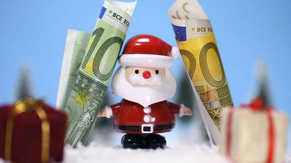 Weihnachtsmann mit Euroscheinen