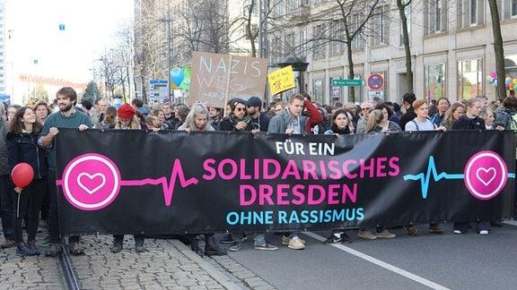 Teilnehmer einer Demonstration in Dresden