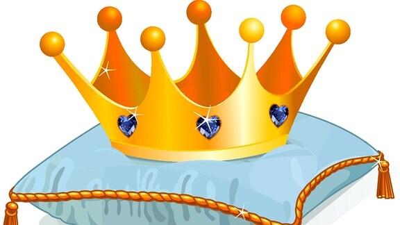 Eine goldene Krone mit Juwelen auf einem Kissen.