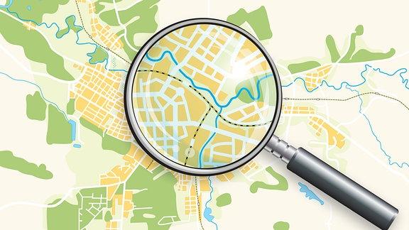 Lupe über Stadtplan