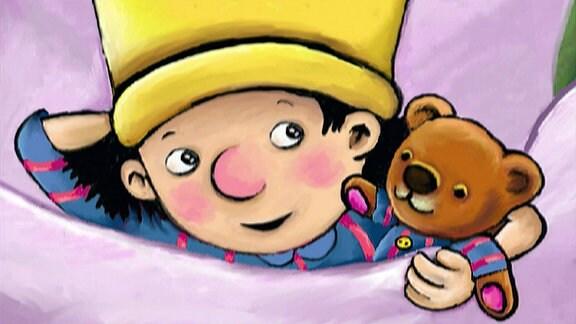 Der kleine König mit Teddy im Bett