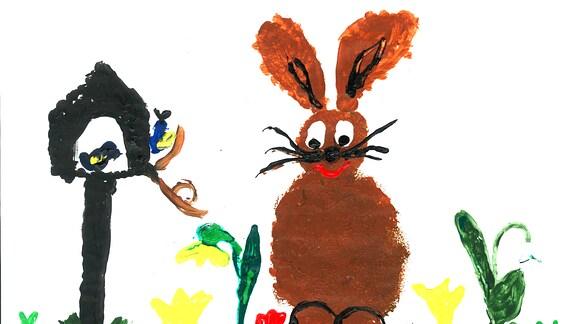 Eine Kinderzeichnung mit dem Osterhasen