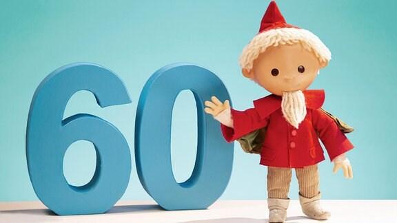 Figur des Sandmann steht neben der Zahl Sechzig und winkt.