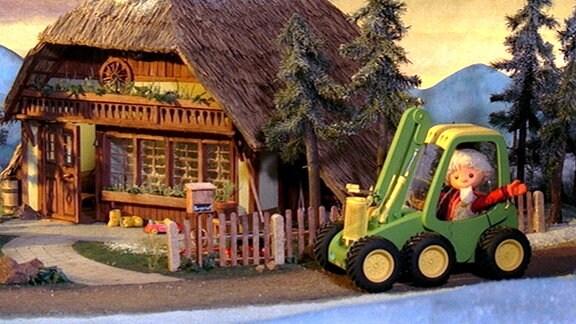 Sandmann steuert einen Harvester