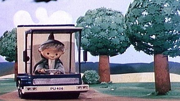 Sandmännchen fährt mit der Fahrbibliothek.