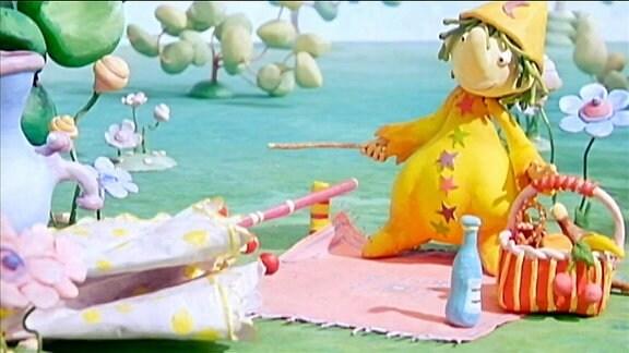 Der kleine Zauberer macht ein Picknick.