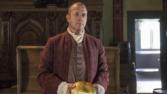 Zum Abschied überreicht der edle Herr und Gewürzhändler (Heino Ferch) seinem Lehrling Hans einen Goldklumpen.